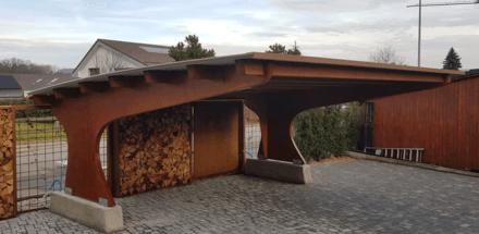 Carport toiture cintrée sur l'arrière